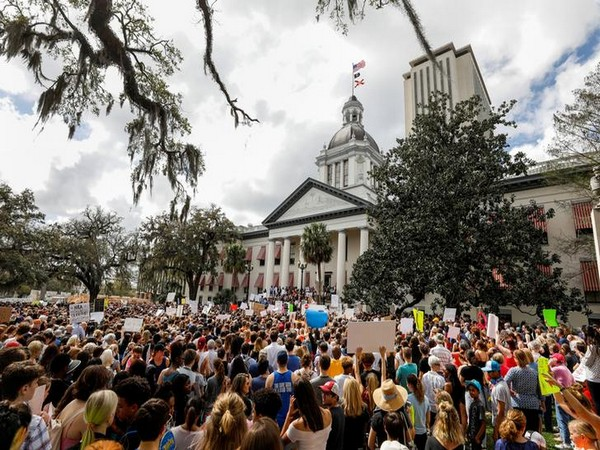 Protestors rally outside the Capitol urging Florida lawmakers to reform gun laws, in Tallahassee