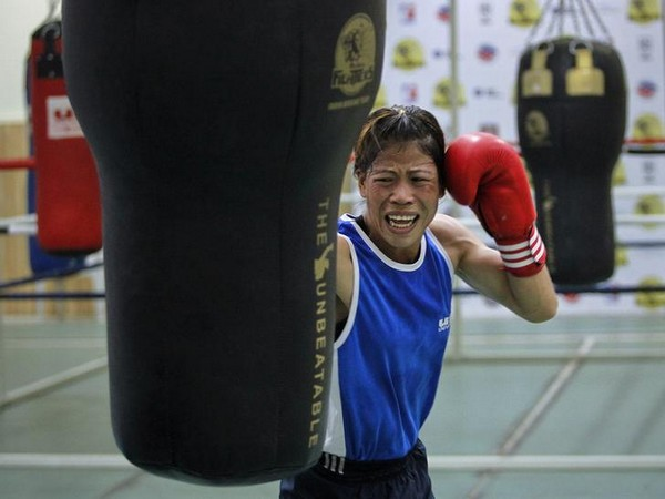 India's boxer MC Mary Kom punches a bag during a training session in Pune