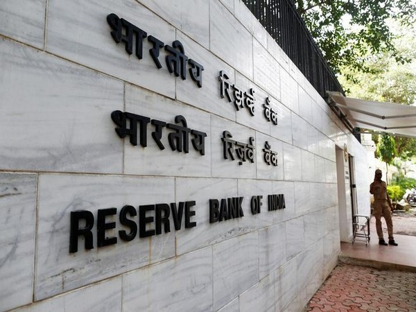 A police officer stands guard in front of the RBI head office in Mumbai