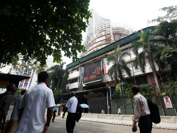 People walk past the Bombay Stock Exchange (BSE) building in Mumbai