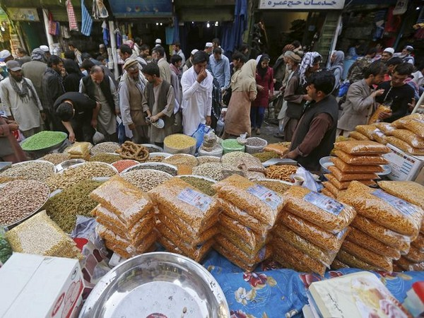 People shop for festive goods in preparation for the Eid al-Adha festival, in Kabul